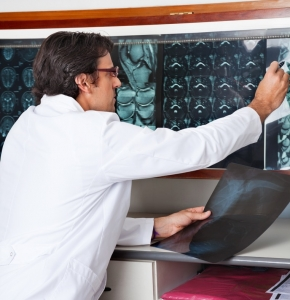Radiologist Reviewing X-ray At Clinic
